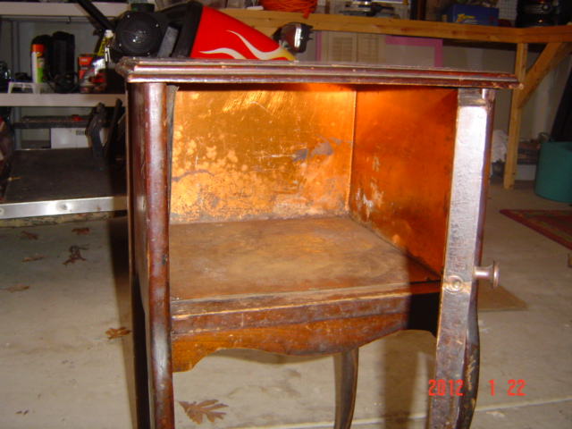 When I got it home and explored it, I realized that the inside of the  cabinet was copper! - A Vintage Humidor Mom And Her Drill