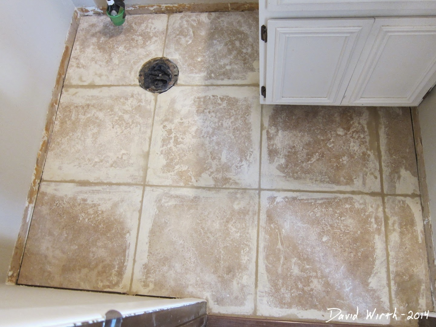 Bathroom remodels part 2 first floor bathroom how to grout a tile floor dailygadgetfo Images