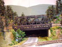 Upgraded warren-truss train bridge with almost-complete scenery