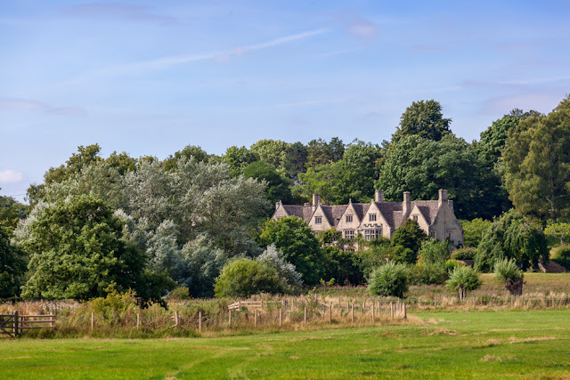 Looking across the Cotswolds countryside to Asthall Manor by Martyn Ferry Photography
