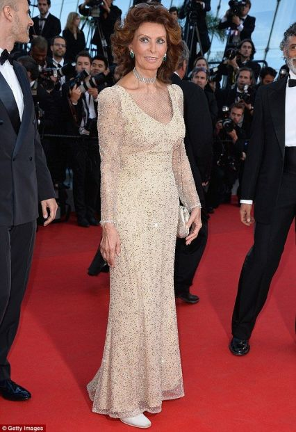 Sophia Loren in a gold Armani Privé gown at Cannes 2014