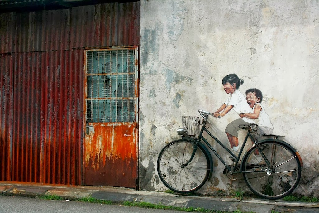 Creative Street art painting sample by Malesian Artist Ernest Zacharevic
