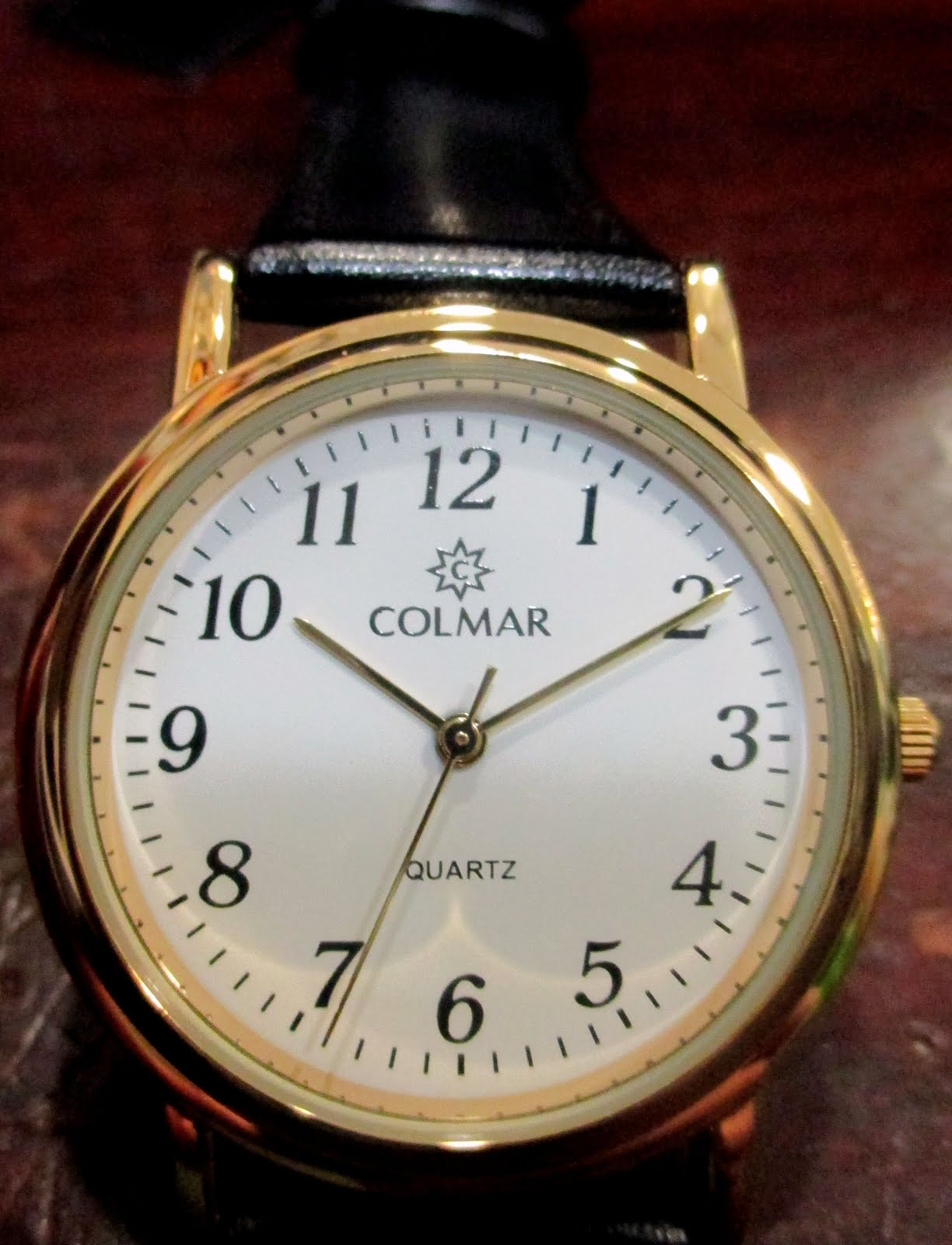 Reloj Colmar dorado señora correa negra numeros grandes