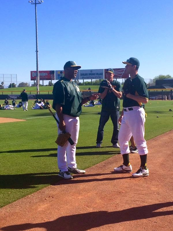 Jim Harbaugh trades khaki pants for baseball pants (and high socks) at Oakland A's spring training.