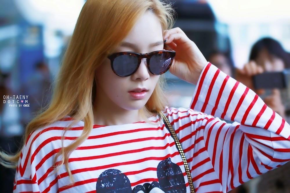 ミッキーTシャツを着た空港の少女時代テヨンの壁紙
