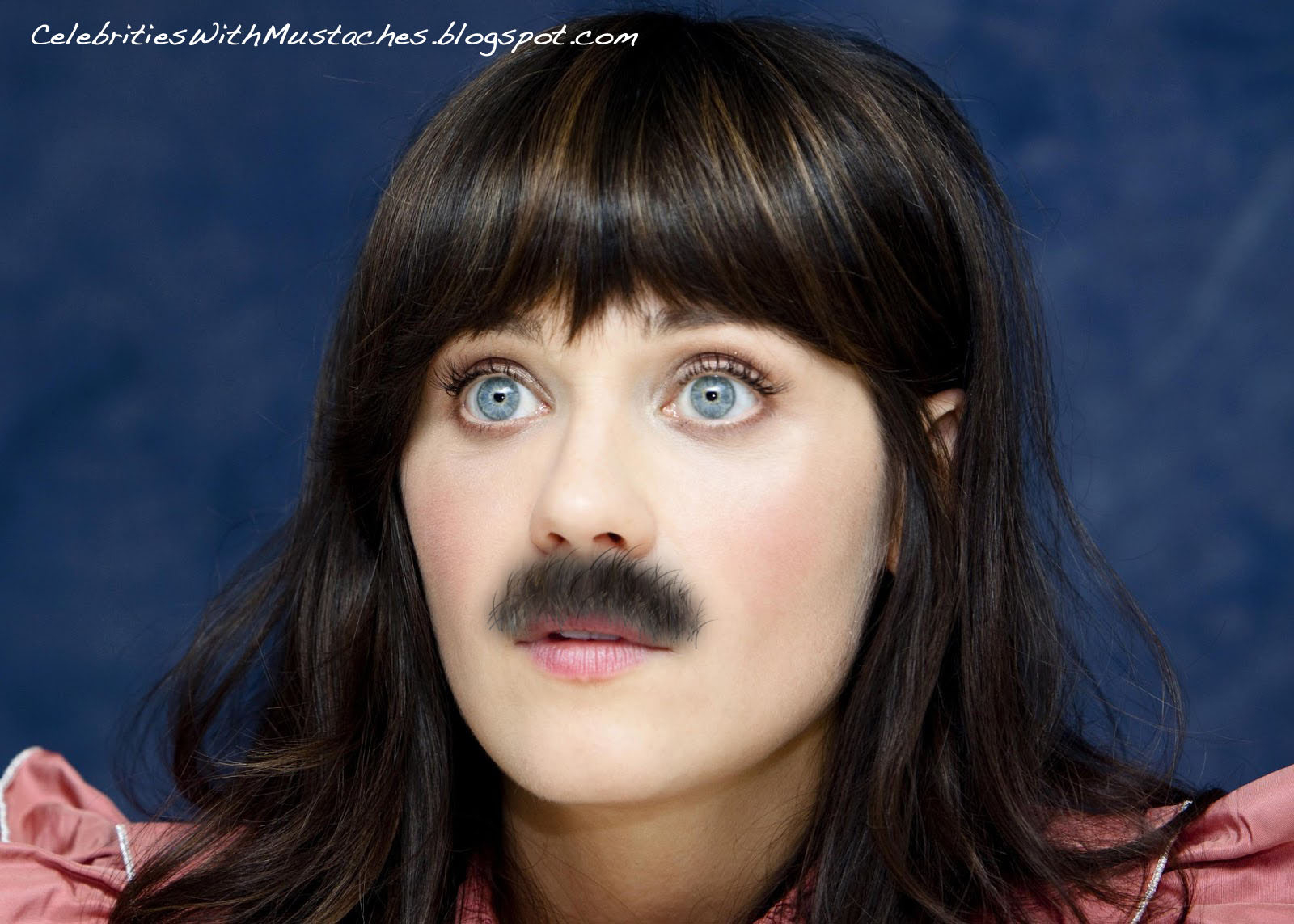 Zooey Deschanel with a mustache