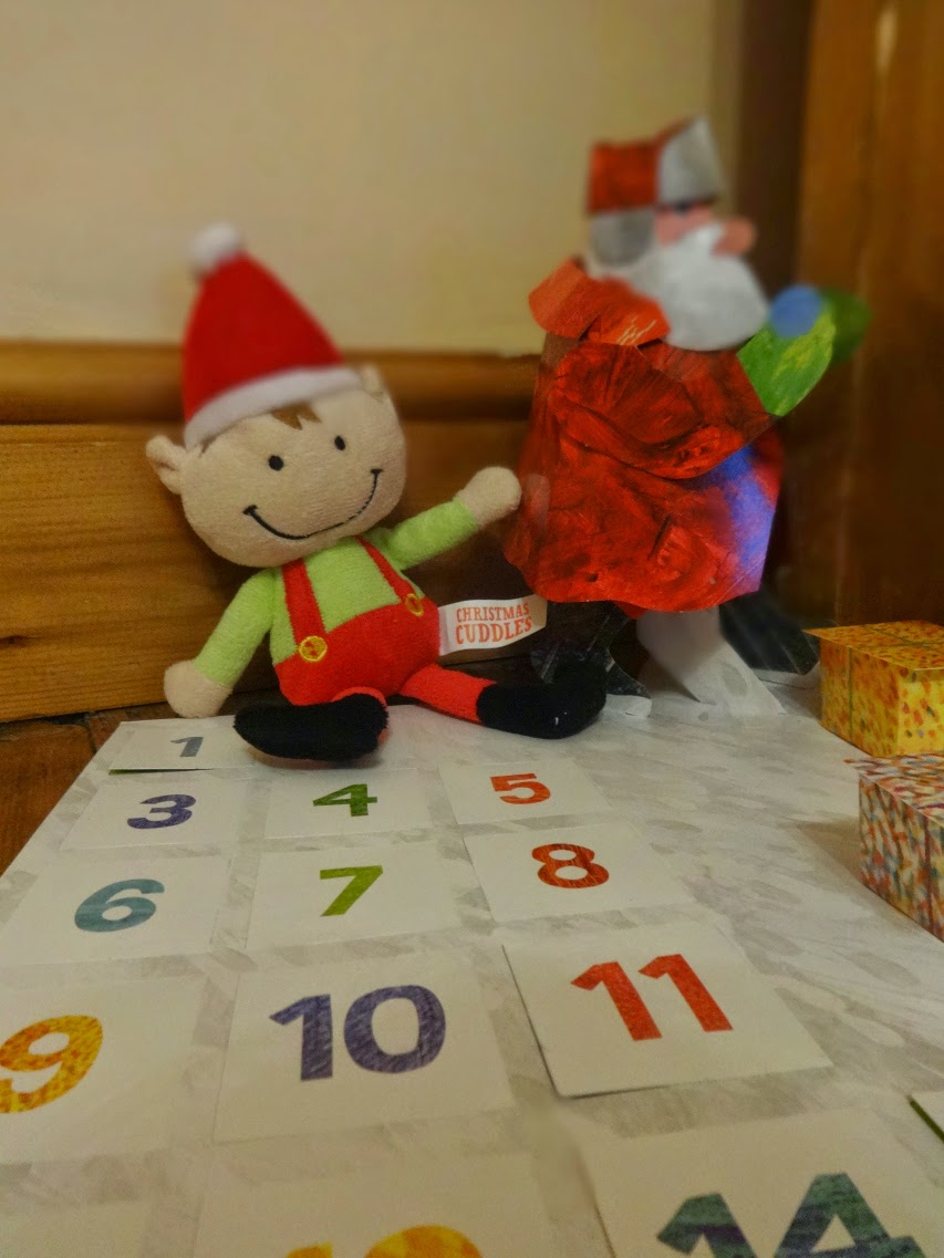 Pop Up Santa from Eric Carle's Advent Calendar and our elf