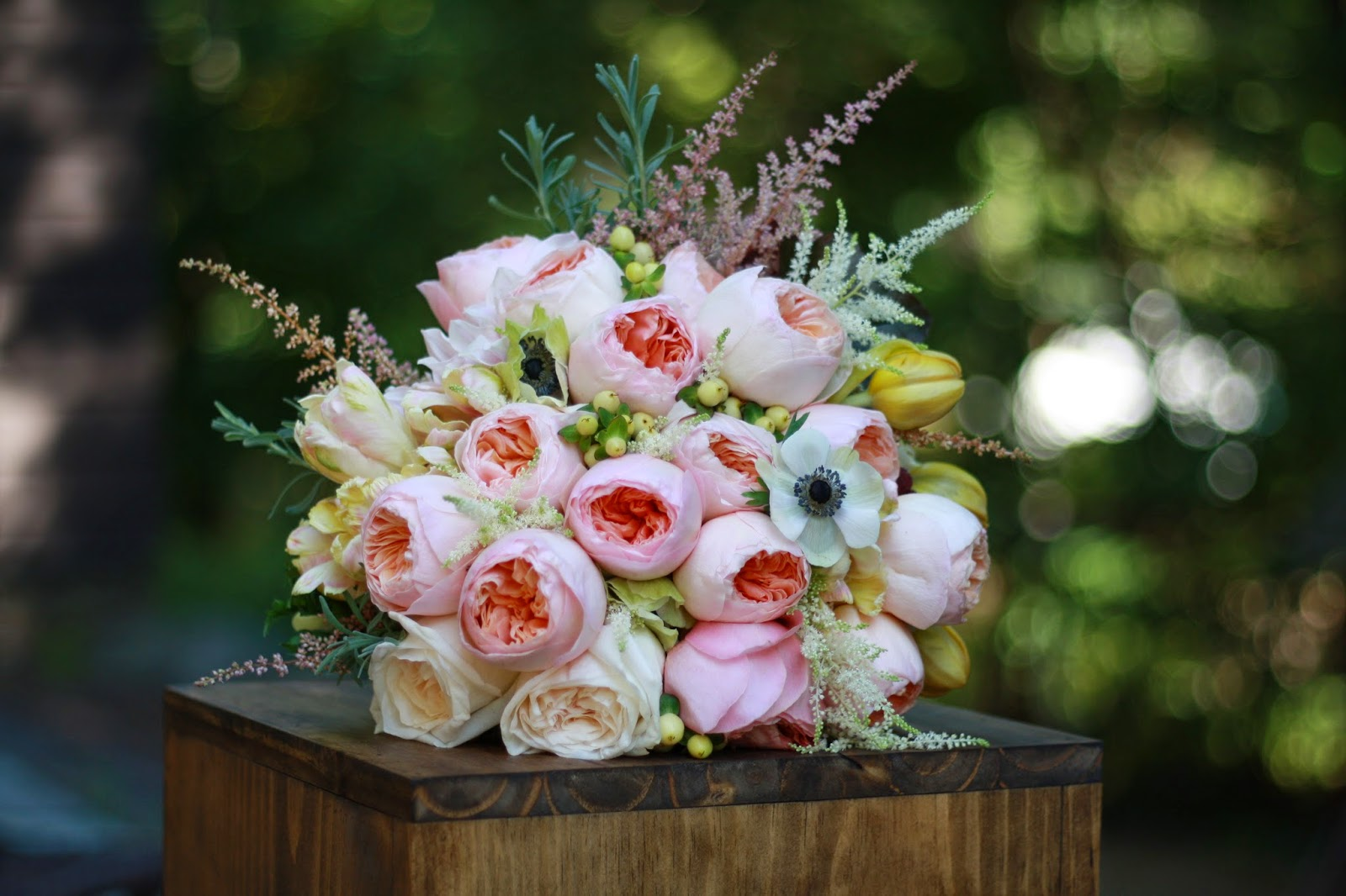 Bridal Bouquet - Elegant, lush and romantic hand-tied bouquet with movement composed of pale peach Juliet garden roses, blush garden roses, café au lait dahlias, anemones, pale pink astilbe, cream hypericum berry, white hydrangea