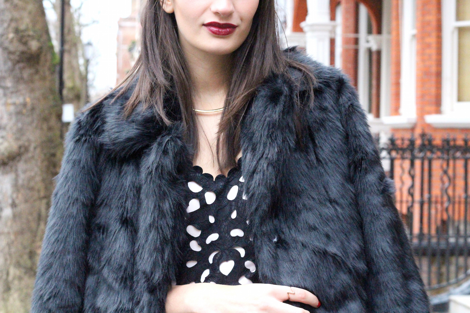 peexo wearing faux fur coat