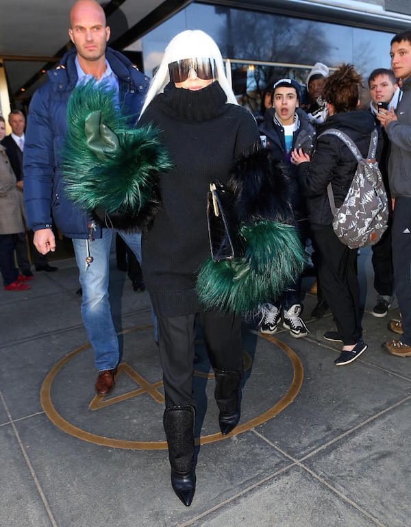 Gaga in Black high neck sweater with green furry sleeves