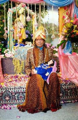 Jagadguru Kripalu Maharaj Ji holding baby Radha in His arms at Radha Madhav Dham, Austin
