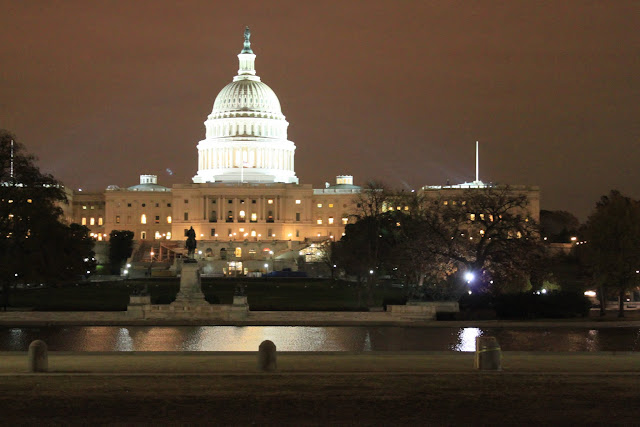 The US Capital from far away at night in Washington DC, USA