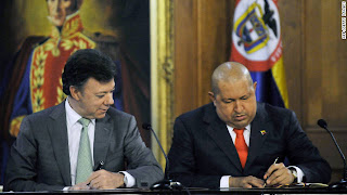 photo of Presidents Chavez and Santos signing