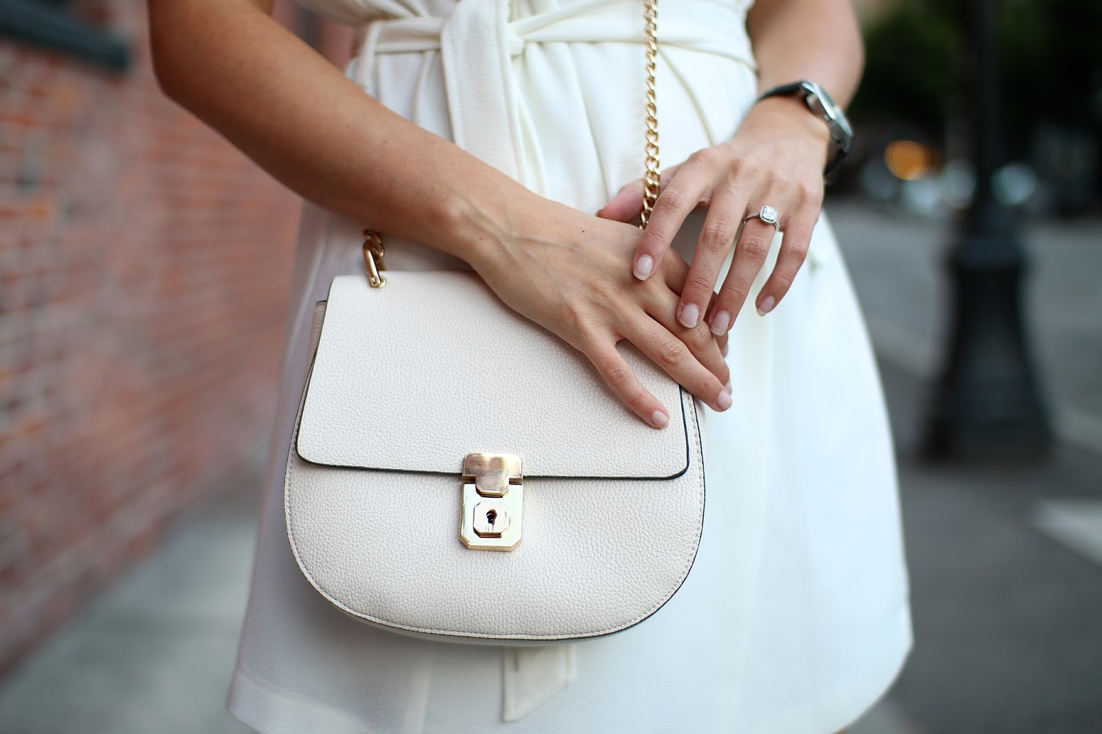 a perfect and pretty dupe of the chloe drew purse in cream, engagement ring