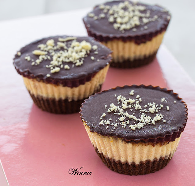 Peanut Butter Mini Cheesecakes topped with Chocolate