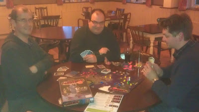 Pandemic - A very poor photo of the guys playing Pandemic. Sorry!