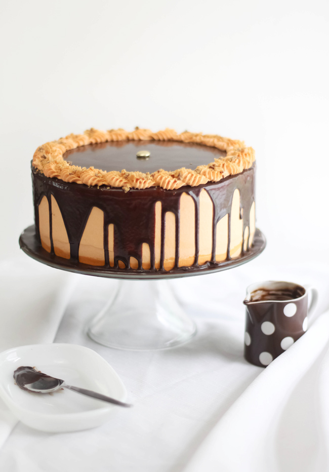 Chocolate-Butterfinger Overflow Cheesecake and Some News!
