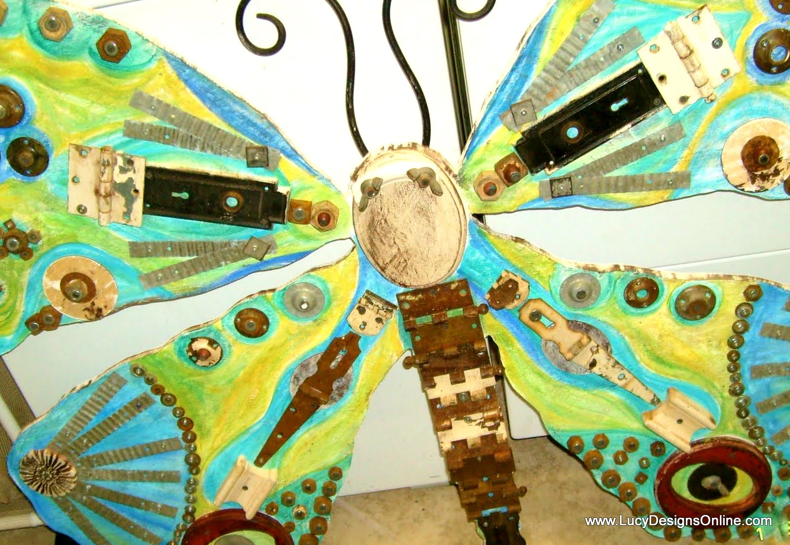 giant recycled junk butterfly art