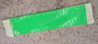 Serampat sandal dari lakban diisi karton atau mika