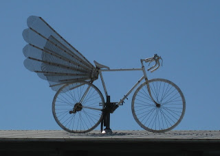 Winged road bike atop the Bike Hut.