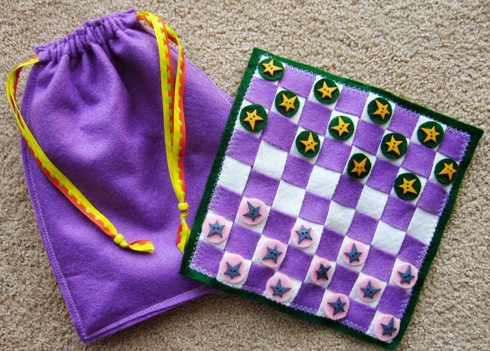 http://www.simplyshoeboxes.com/2015/01/diy-travel-checkers-game-with.html