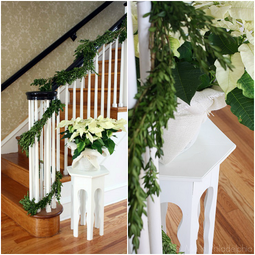 stairs garland and white poinsettia via Meet Me in Philadelphia