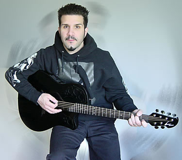 Charlie Benante with his electric guitar