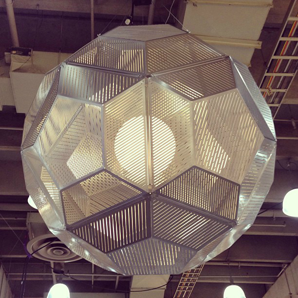 Mod design guru fresh ideas cleverly modern design celebrate tom dixons giant laser cut metal light fixture hung over its trulab machinery the equipment that fabricates its lights metal construction mozeypictures Image collections