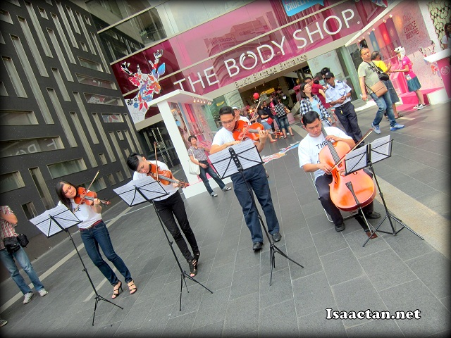 Playing a mini orchestra in the middle of the busy shopping mall, Pavilion KL