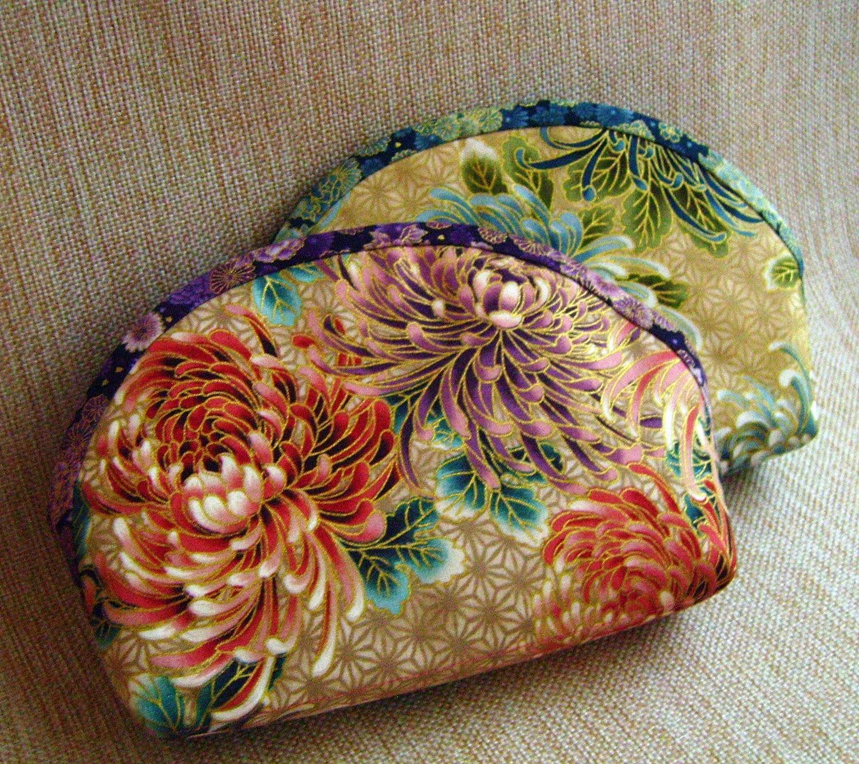 клатч-косметичка  из ткани с золотым напылением