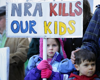 Child protesting the NRA