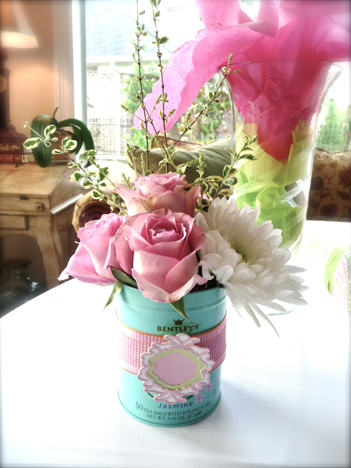 The shiny pebble a baby shower i used tea canisters as containers for my flower arrangements dhlflorist Images