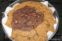 choc chip cookie pie with chickpeas, baked and in the pan, showing chocolate centre
