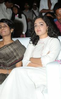 Nithya Menen Pictures in White Long Dress at Malli Malli Idi Rani Roju Audio Launch    ~ Bollywood and South Indian Cinema Actress Exclusive Picture Galleries