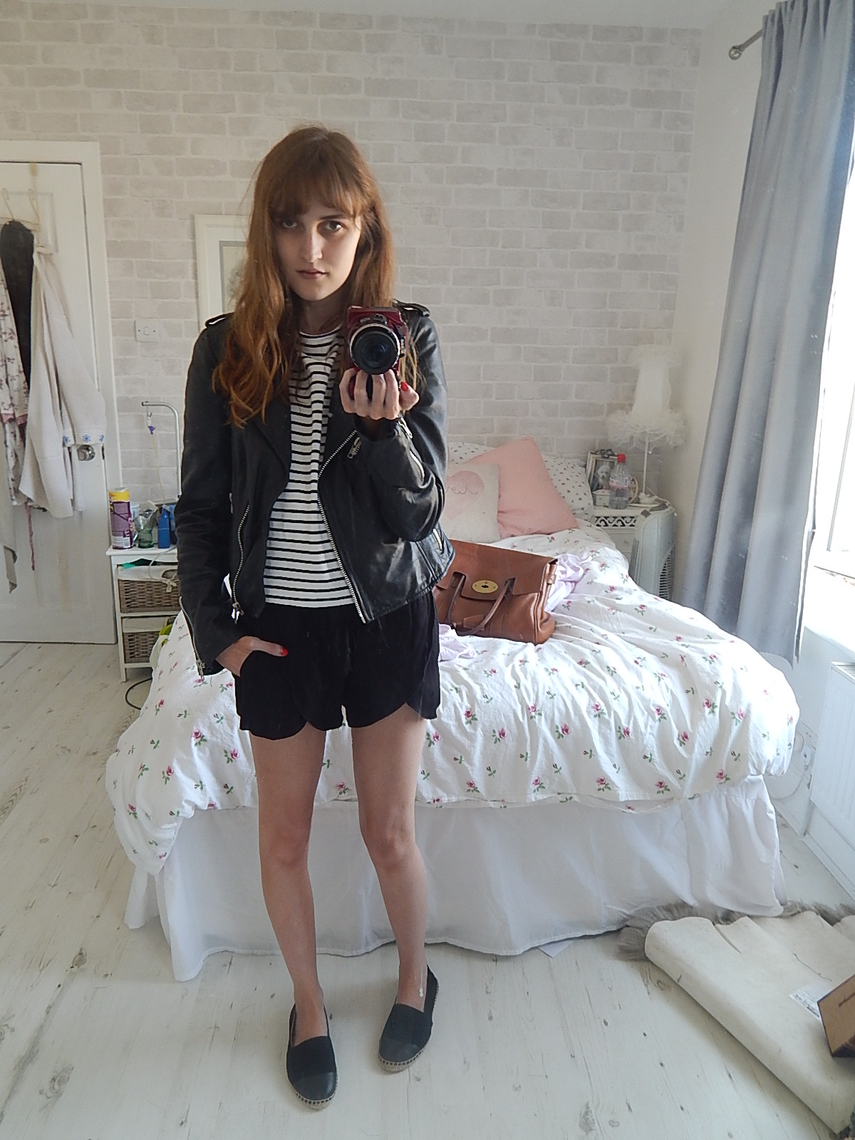 leather jacket and shorts outfit