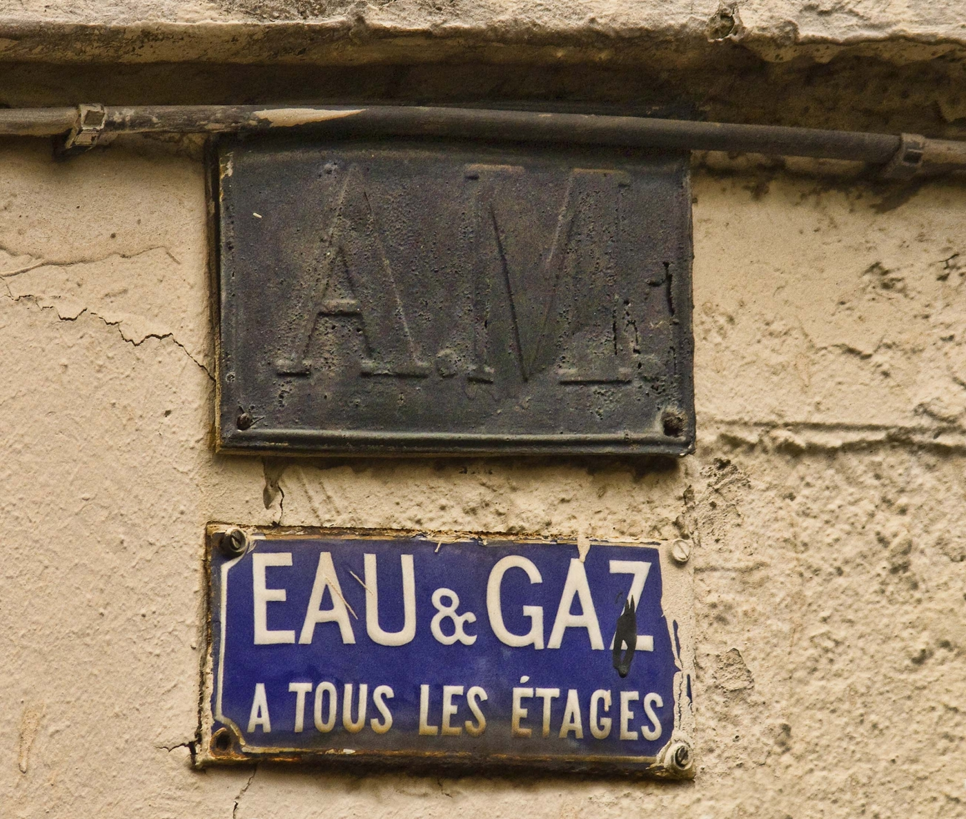 Paris myope la providence l 39 union la paix for Plaque w garage assurance