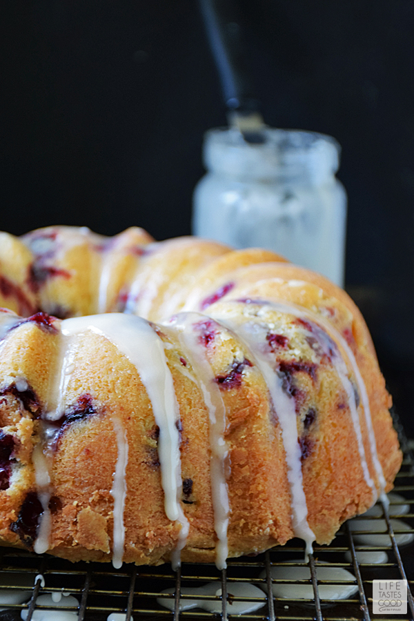 If you are looking for A festive dessert to serve this holiday season, you are definitely in the right place! This Cranberry Bundt Cake | by Life Tastes Good has fresh cranberries with a sweet orange glaze that will be the hit of the party! #LTGrecipes