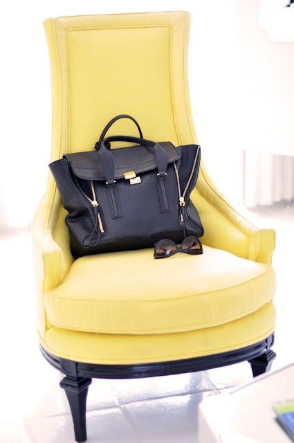 black bag + yellow chair