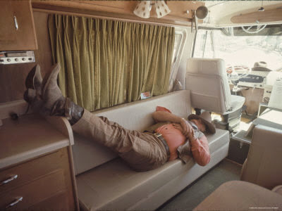 "Wayne in his motorhome, (home away from home), taking a break while filming ""The Undefeated""."