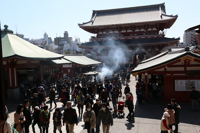 It's getting crowded with Japanese and the visitors at the main temple's hall of Asakusa Sensoji Temple in Tokyo, Japan