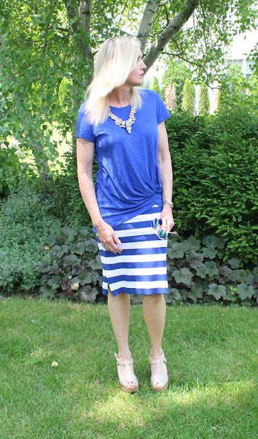 Happiness Boutique Snow White statement necklace with cobalt knotted tee and striped pencil skirt