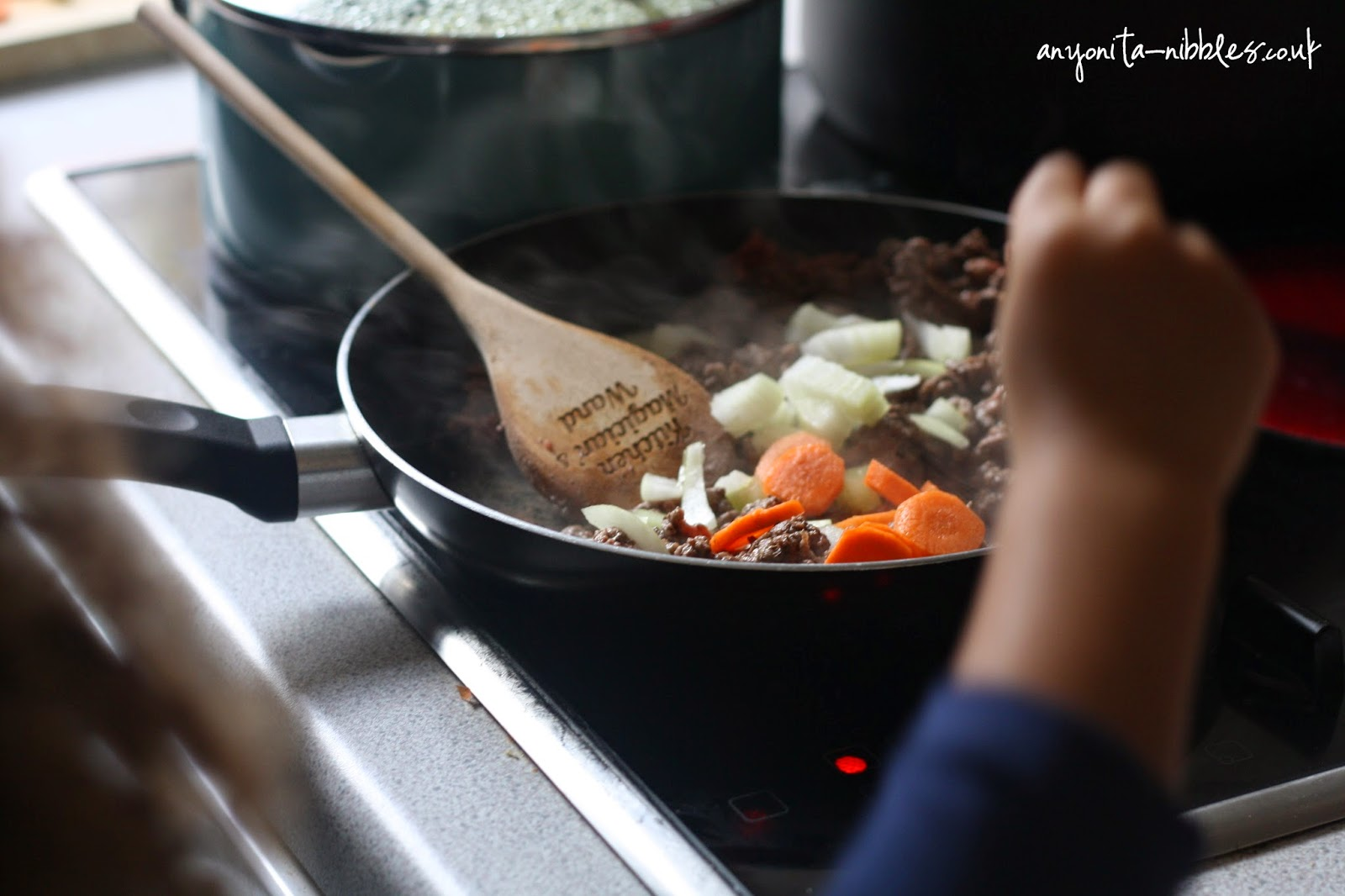 Adding vegetables for cottage pie from Anyonita-nibbles.co.uk