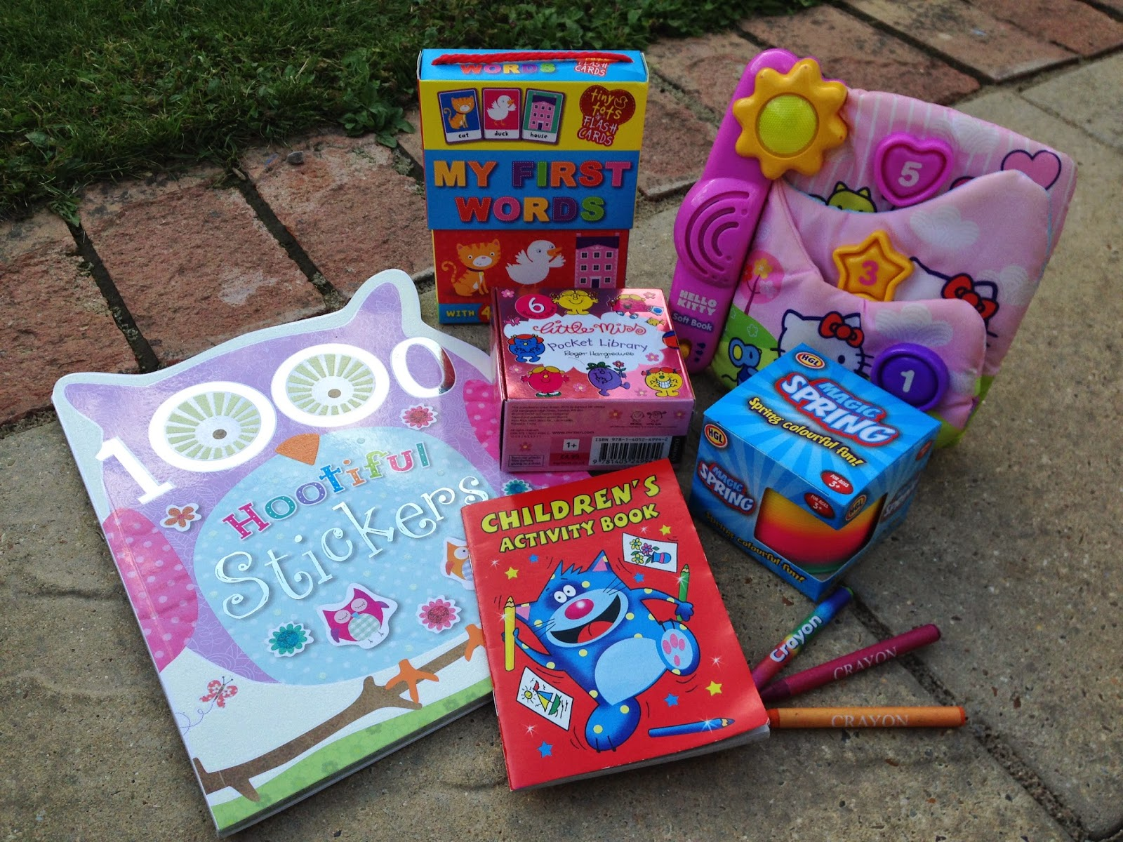 Sticker book, flash cards, slinky soft book, colouring book, card books
