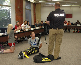 SHSU University Police demonstrate a restraining device.