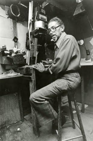 "Prentice ""P.H."" Polk in his studio at his 4x5 enlarger"