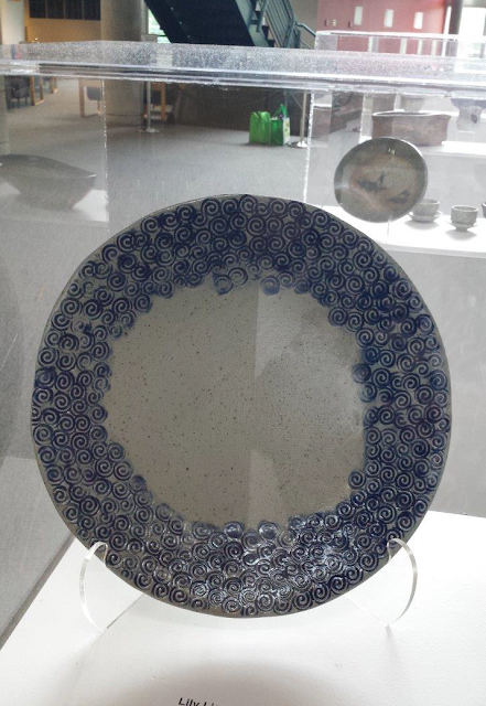 Swirly pattern stoneware pottery bowl / platter by Lily, on display at Shadbolt Centre in Burnaby.