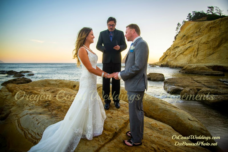 bride groom and officiant getting married on Cape Kiwanda with blue ocean
