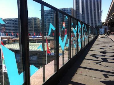 vivid sydney window decals on circular quay station platform