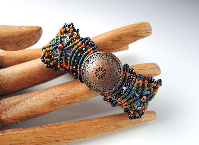 Copper button focal in micro macrame by Sherri Stokey.
