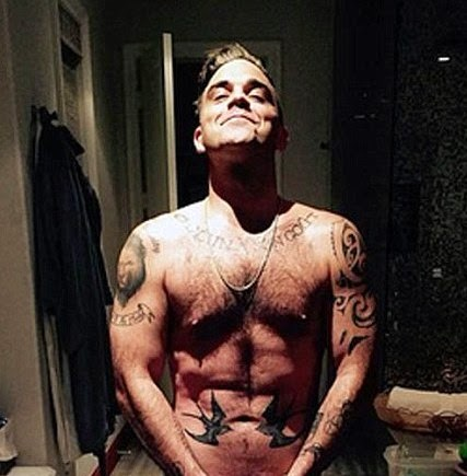Robbie Williams poses naked on his birthday to reveal impressive six pack